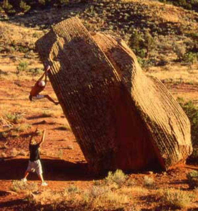 Ian Spencer-Green bouldering on the Split Boulder in Indian Creek Canyon, Utah.