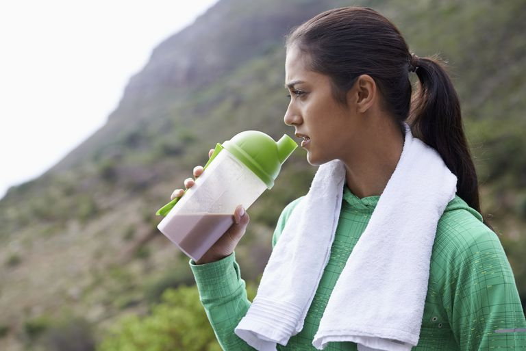 Woman drinking protein shake after exercise