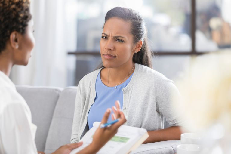 Confused woman listens to counselor