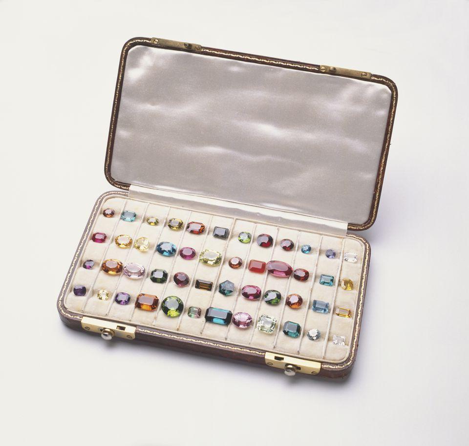 Case of colourful polished gemstones