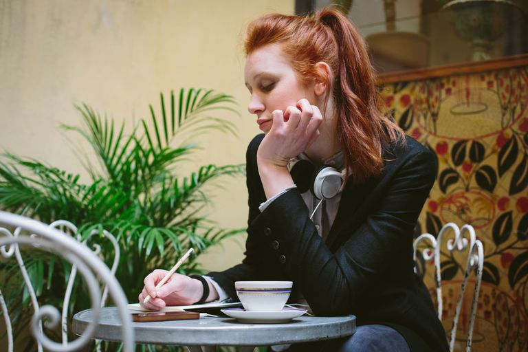 young woman alone drinking coffee