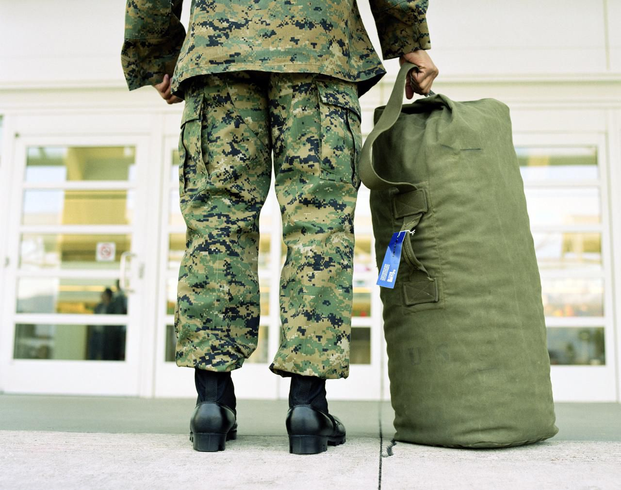 Chapter 61 medical discharge - Military Soldier With Bag In Airport Low Section