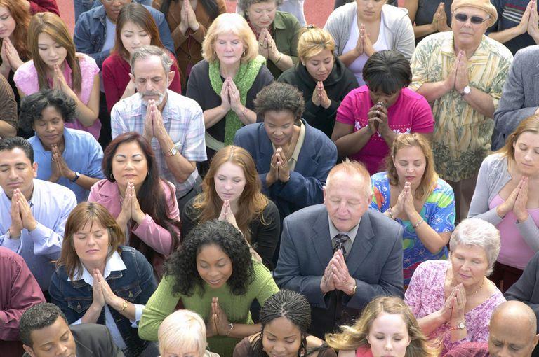 people praying prayer crowd