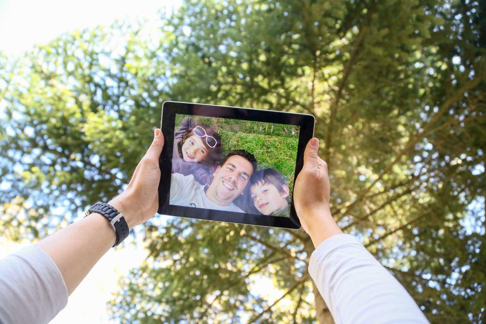 Man taking selfie with children outside
