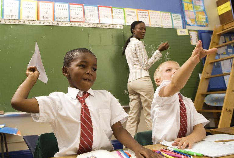 Two Boys in a Classroom with Paper Aeroplanes. Cape Town, Western Cape Province, South Africa