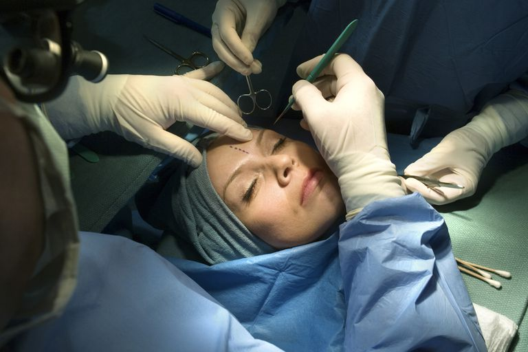 A patient undergoes cosmetic surgery.