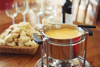 Traditional Cheese Fondue With Cognac Or Kirsch Brandy