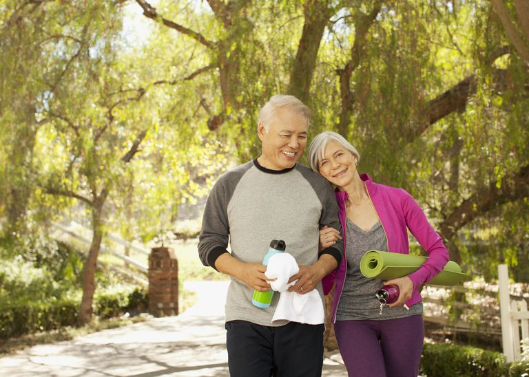 Mature couple with exercise equipment.