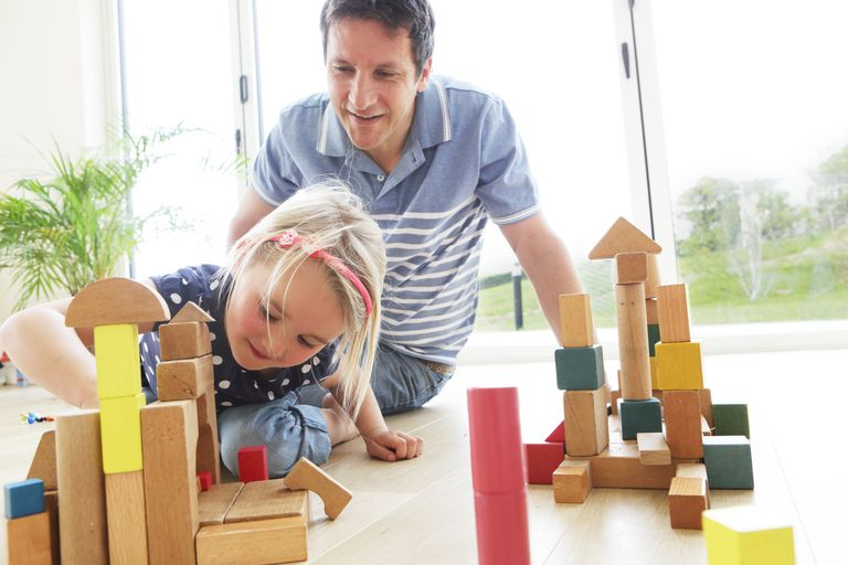 dad and daughter playing with blocks