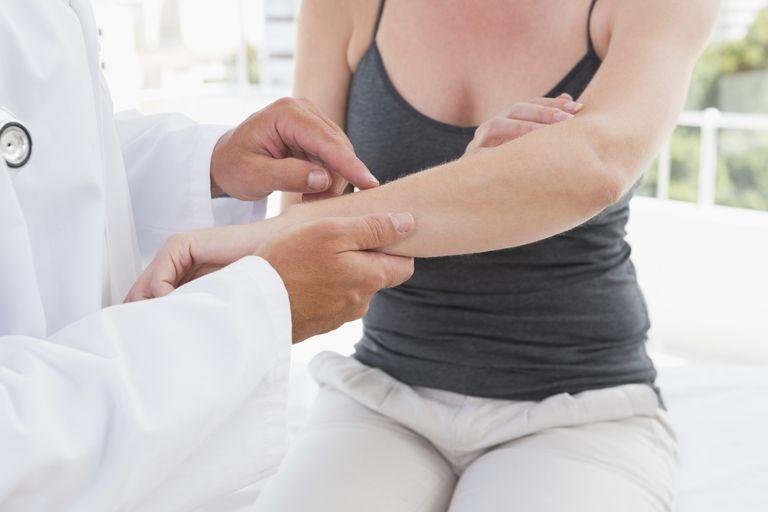 Doctor examining woman