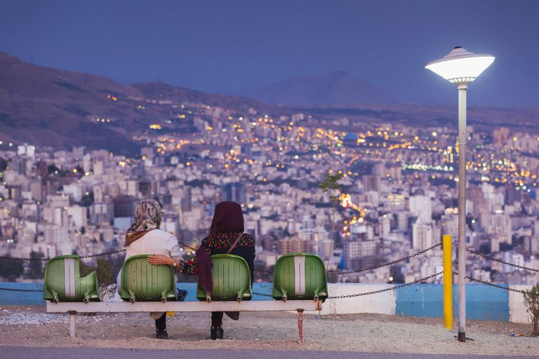 Iran, Tehran, visitors to the Roof of Iran Park above the city skyline