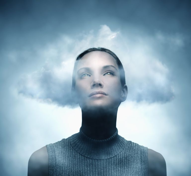 Woman with her head in the clouds