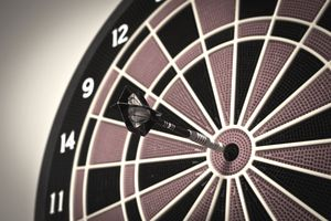 dart board with dart on target