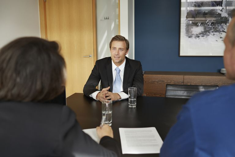 man interviewing with resume on table