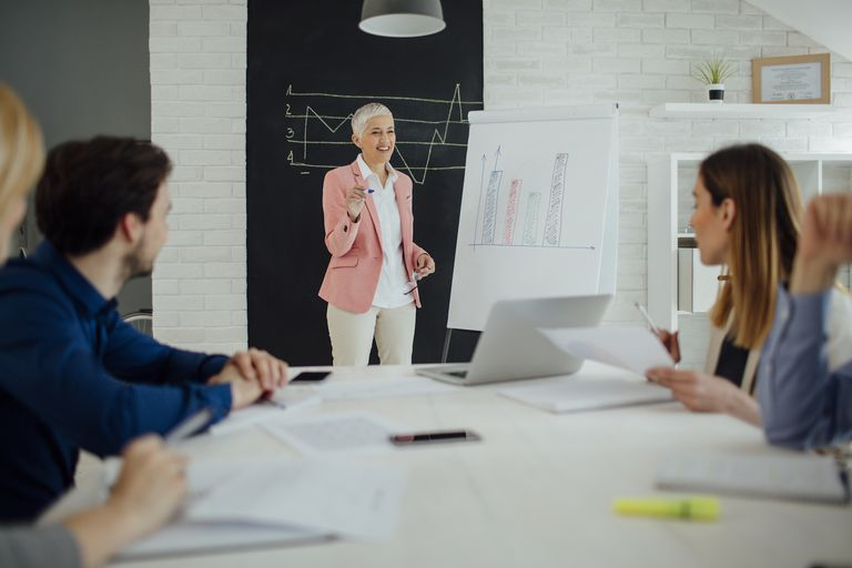 Woman giving presentation in conference room