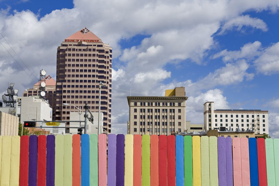 Colorful fence and skyline.