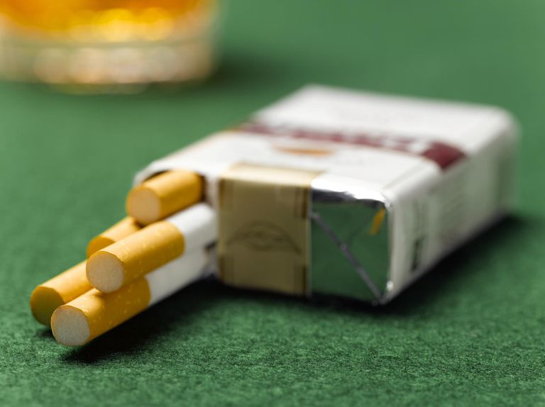 Cigarette pack open on table, close-up