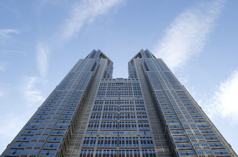 Tokyo skyscraper, 48 floors, two-towered design, postmodern coloring