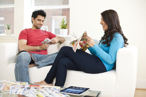 Couple clipping coupons