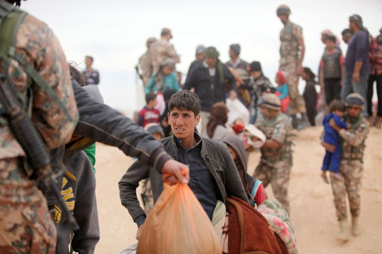 Group of Syrian refugees entering Jordan