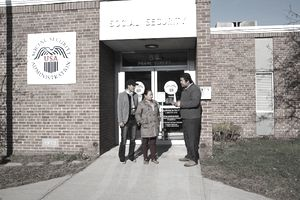 people standing in front of a social security office