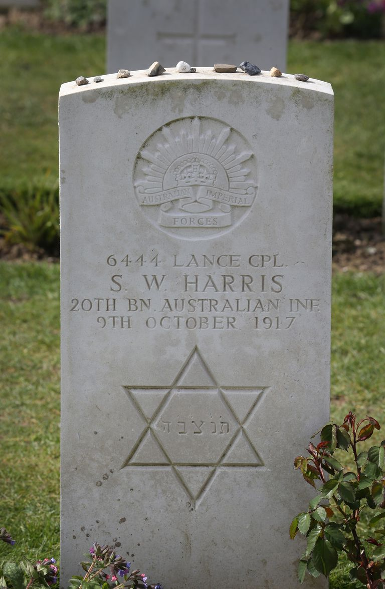 Small stones, a Jewish tradition, are left on top of a headstone at Tyne Cot cemetery on March 26, 2014 near Passchendaele, Belgium.