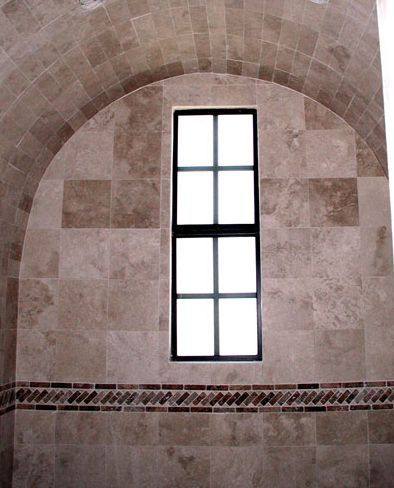 shower with arched ceiling