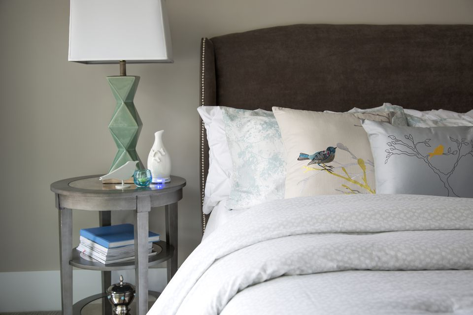 Bird pillows on elegant bed