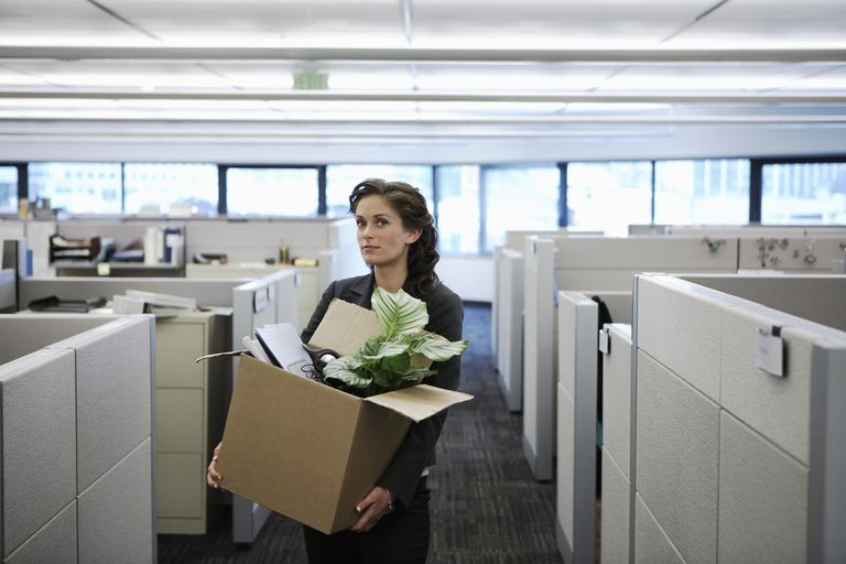 Use a layoff termination letter to lay off employees young businesswoman carrying cardboard box in office portrait spiritdancerdesigns Image collections