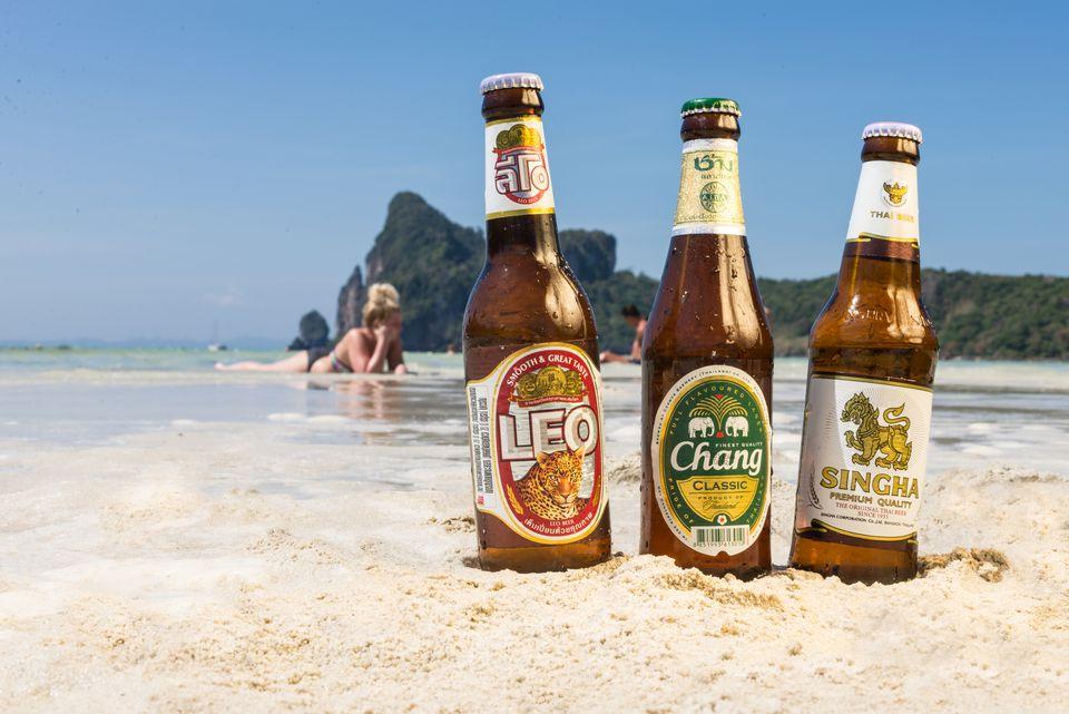 Bottles of the top three beer brands in Thailand stuck in sand