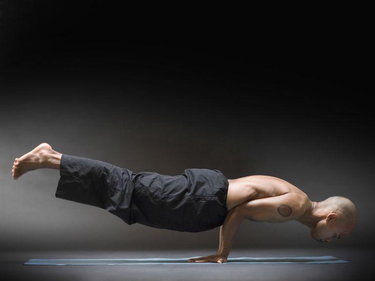 Man in Peacock Yoga Pose (Mayurasana)