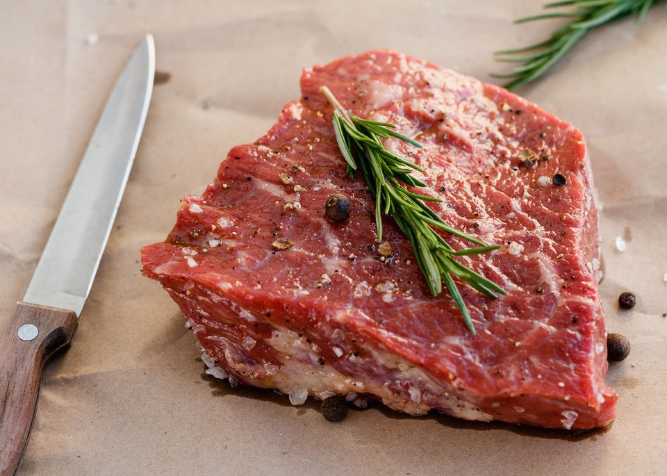 Raw Beef with Rosemary Sprig