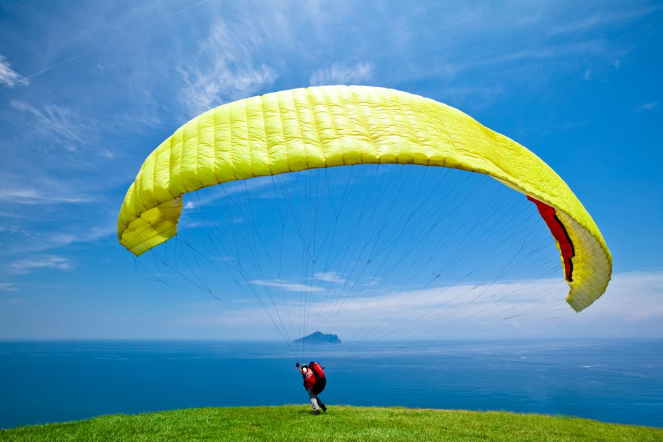 Paragliding with beautiful cloudscape background