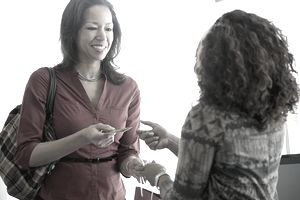 Woman sharing business card