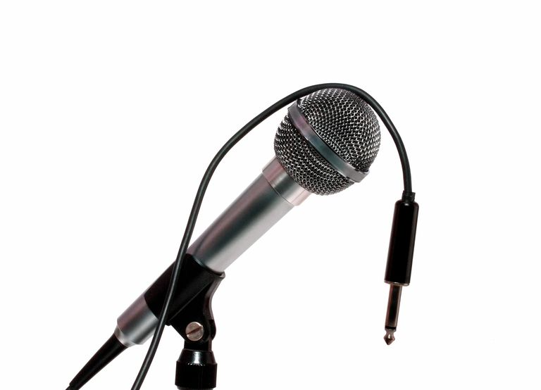 A disconnected microphone resting on a stand
