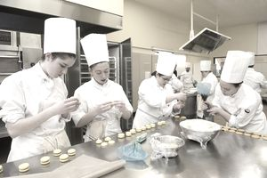Apprentice chefs making biscuits