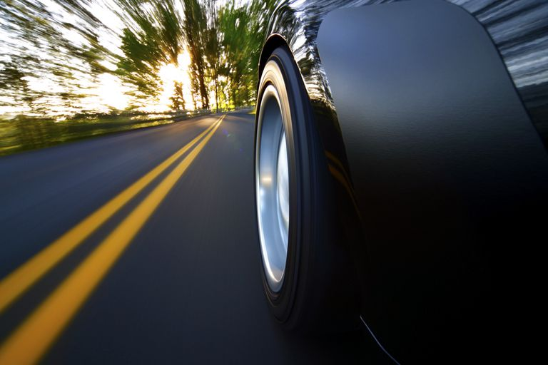 Rear view of sports car on a sunset drive