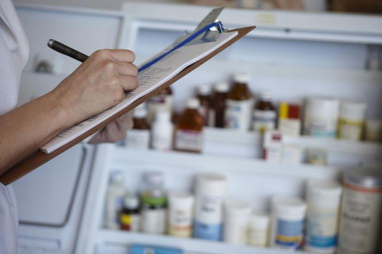 Nurse taking stock of pharmaceutical drugs