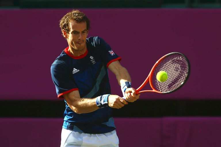 LONDON, ENGLAND - AUGUST 05: Andy Murray of Great Britain plays a backhand next to his partner Laura Robson of Great Britain during the Mixed Doubles Tennis gold medal match against Victoria Azarenka of Belarus and Max Mirnyi of Belarus on Day 9 of the London 2012 Olympic Games at the All England Lawn Tennis and Croquet Club on August 5, 2012 in London, England.