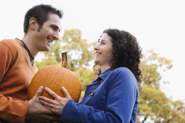 Couple pumpkin picking