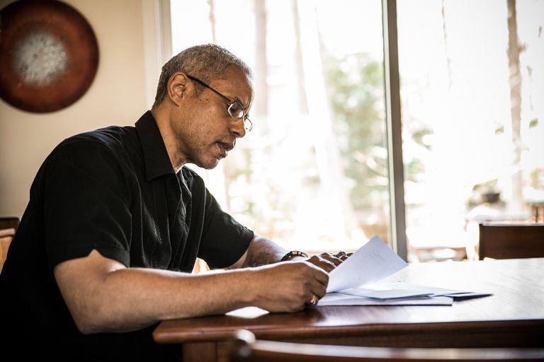 Man looking at bills