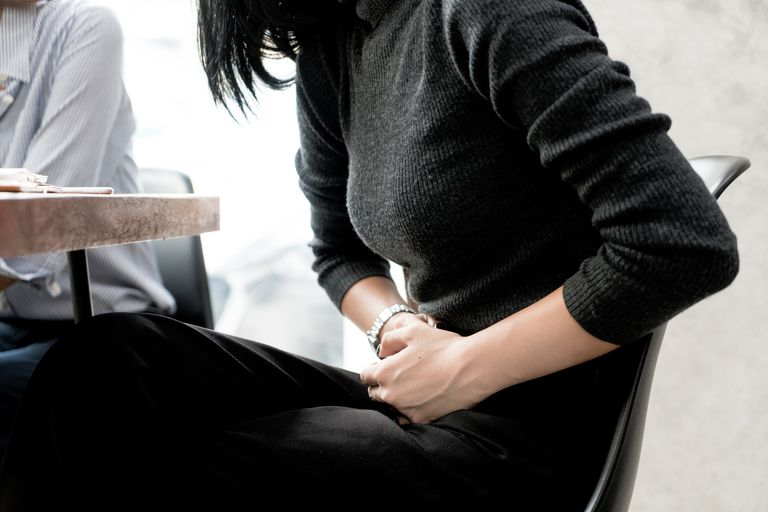 Asian woman has stomachache while she meeting with her friend in cafe. Asian woman has stomachache while she meeting with her friend in cafe.