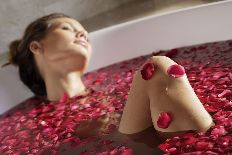 Woman in a bathtub, illustrating About.com's Spa Sweepstakes List.