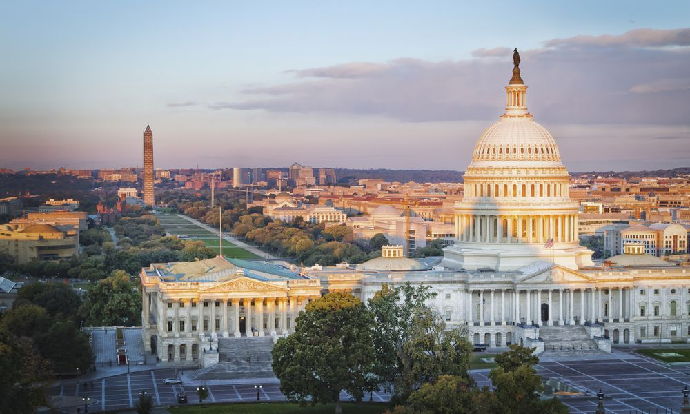 US Capitol Building, National Mall and Northwest Washington at sunrise from Library of Congress, Washington DC, USA