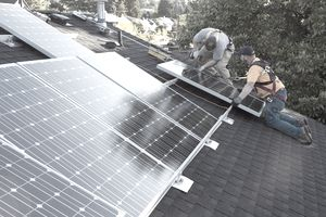 Men installing panels on roof