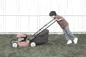 kid mowing a lwan