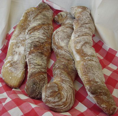 Fresh loaves of Swiss Wurzelbrot on a Checkered Cloth