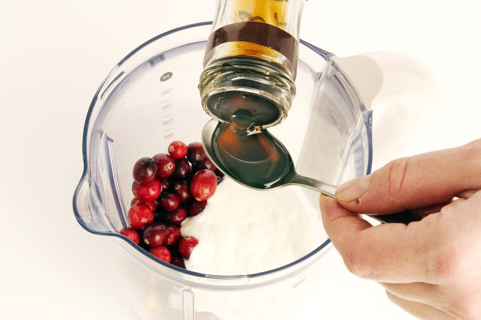 Step 3 - Adding maple syrup to smoothie ingredients