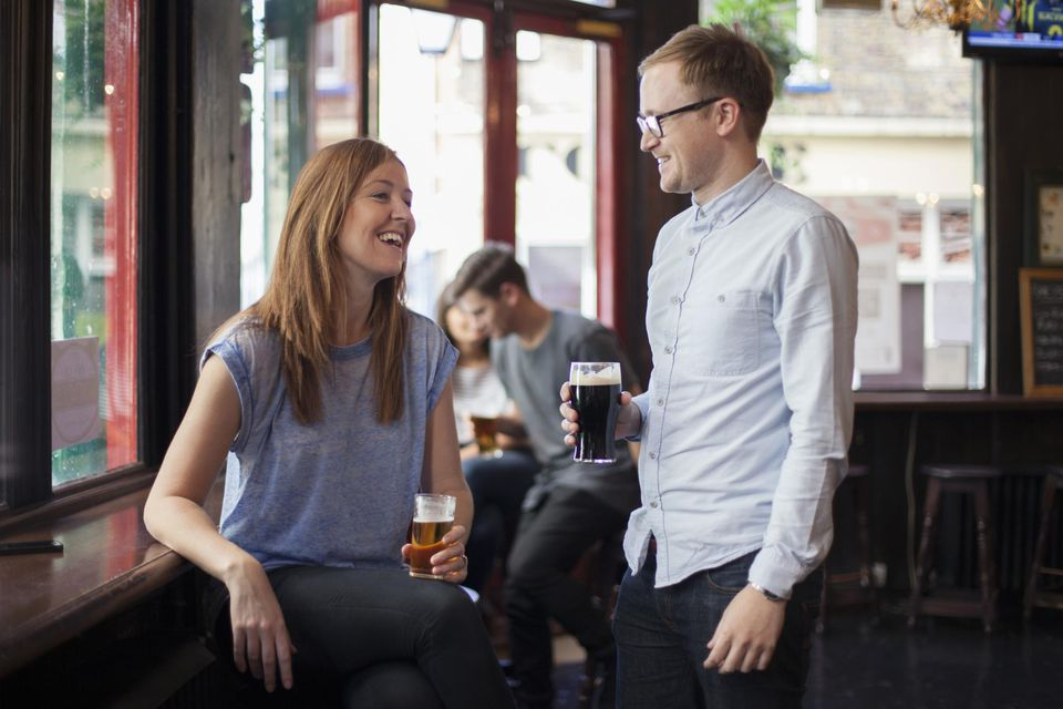 woman chatting with a friend in a pub