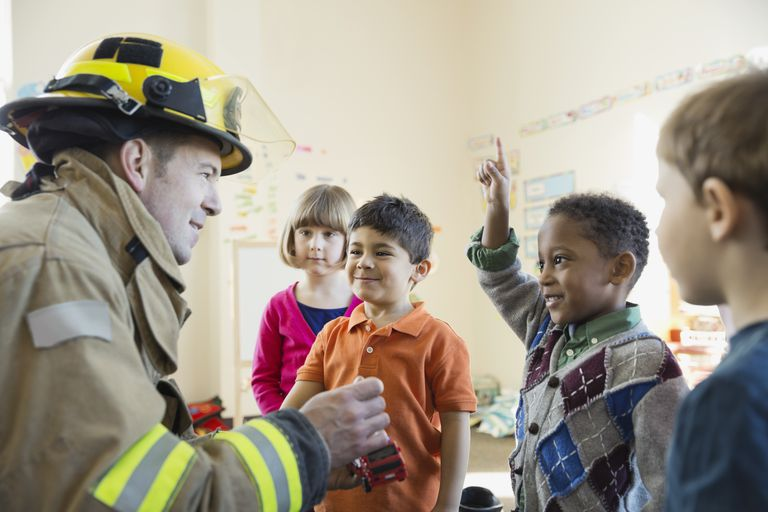 Firefighter with students in elementary school